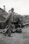 Man selling pears on East Siberian railway by Harbin, China in 1924