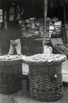 Baskets of fruit at a bazaar in Fushun, Manchuria in northern China in 1924