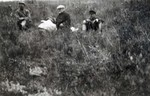 N.E. Hansen and two assistants on their search for hardy peach trees in northern China in 1924