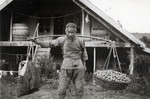 Local man assisting N.E. Hansen while he conducts pear research at Saolin in northern China in 1924