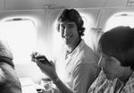 South Dakota basketball delegation player in airplane