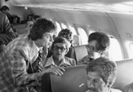 South Dakota basketball delegation in airplane