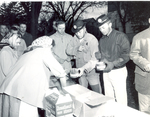 Cooks dishing out Hobo Day Bum stew at South Dakota State College, 1957
