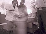 Dishing up Hobo Day Bum stew at South Dakota State College, 1957