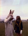 Cheerleader and Jackrabbit mascot at South Dakota State University, 1970