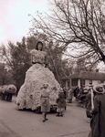 Giant woman Hobo Day parade float, 1947