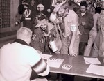 Registration for the Hobo Day parade at South Dakota State College, 1957